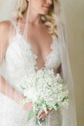 small bridal bouquet with white sweet peas and lily of the valley