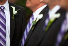 Groom and groomsmen wearing purple ties