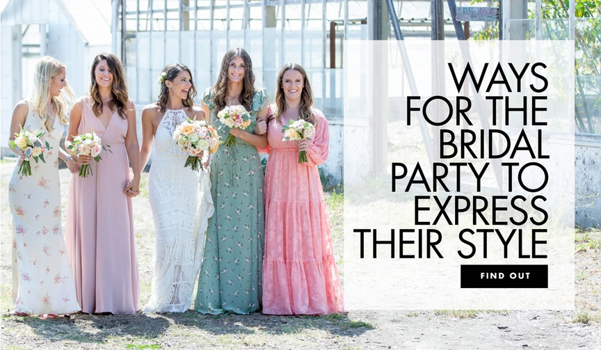 mismatched bridesmaids in floral, pink, and blue dresses with boho-chic bride