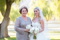 Bride in a strapless Hayley Paige dress, veil with mother in a silver Soulmates outfit