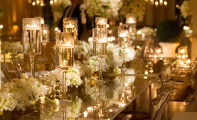 White and gold wedding decorations with clear table