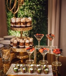 Wedding reception dessert table chocolates on gold cake stand berries in martini glass wedding ideas