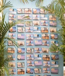 Destination wedding beach ceremony escort card idea postcards with guest names attached on tags
