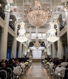 wedding ceremony corinthian ballroom houston floating candles white flowers chandeliers orchid halo