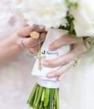 wedding bouquet white flowers exposed stems wrapped with grandpa handkerchief grandma rosary beads