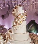 ron ben israel wedding cake white and gold with sugar flowers cascading down tiers