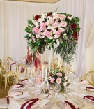 round tablescape champagne hued linen tall centerpiece patterned pink red white flowers low candles