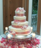 Four-tier wedding cake in pink and white