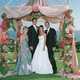 chuppah made of ivory fabric and pink and green flowers