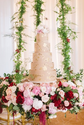 5 five tier champagne hued cake floral chandelier gold red pink white greenery fresh flowers