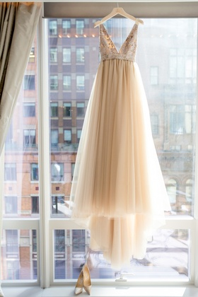 champagne colored bridal gown window nyc v-neck unique tulle manolo blahnik heels shoes