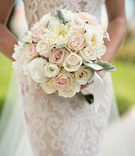 Bride in Ines Di Santo wedding dress holding bouquet with pink and white rose flowers peony dahlia