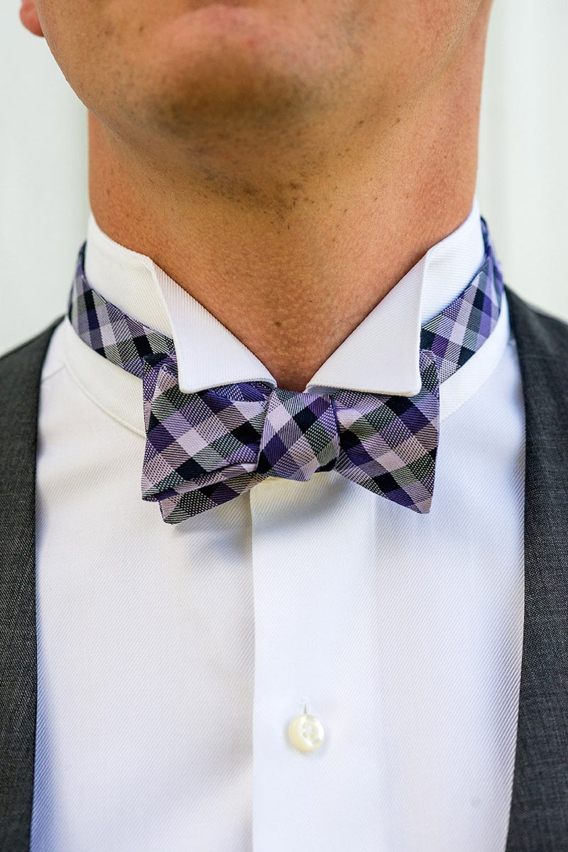 Groom groomsmen attire with grey vest and purple plaid bow tie