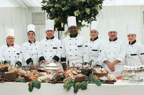 Caterers in white and black chef uniforms