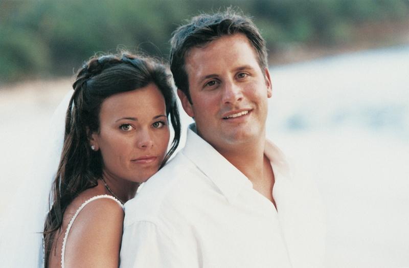 newlyweds at beach wedding