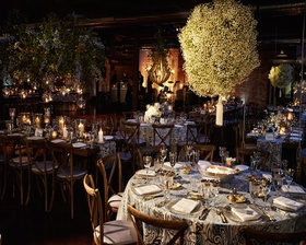 Floral & light hanging decor accenting table centerpieces.