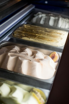 Various flavors of gelato ice cream in silver trays