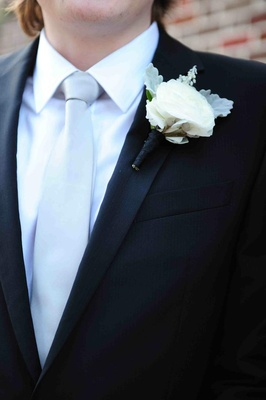 White rose boutonniere with dusty miller and foliage