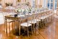 wedding reception ballroom mirror head table blue white candlestick and soft white green centerpiece