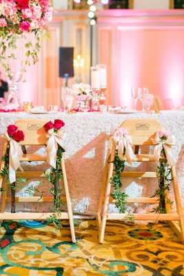 Wedding reception vow renewal highchairs for little young guests decorated with greenery and roses