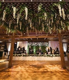 rustic chic wedding reception the gold coast all stars stage trellis over dance floor with greenery