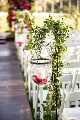 wedding ceremony aisle etched glass candle holder on shepherd hook pink flower candles greenery
