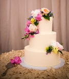 simple wedding cake with colorful fresh flowers