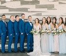 bridesmaids in pale blue and blush hues, groomsmen in blue suits