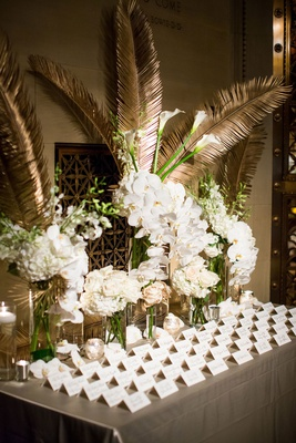 wedding reception escort card table white rose hydrangea orchid gold palm leaf frond escort cards