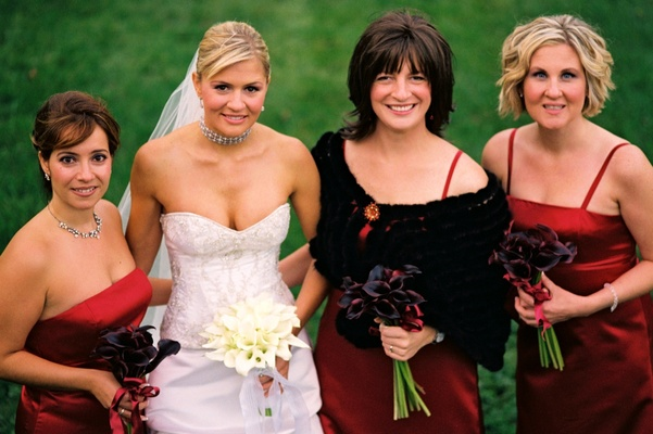 Bridesmaids in red dresses with fur boleros