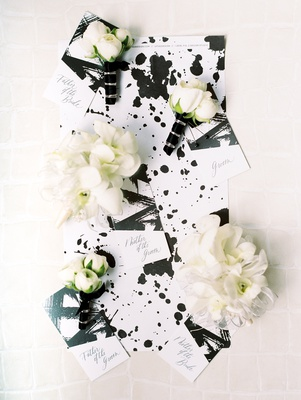 modern, chic black and white wedding programs brush stroke and paint splatter