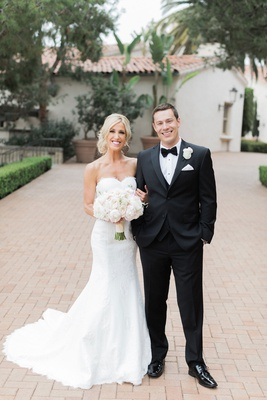 bride in angel rivera wedding dress from the white dress groom in tuxedo bow tie