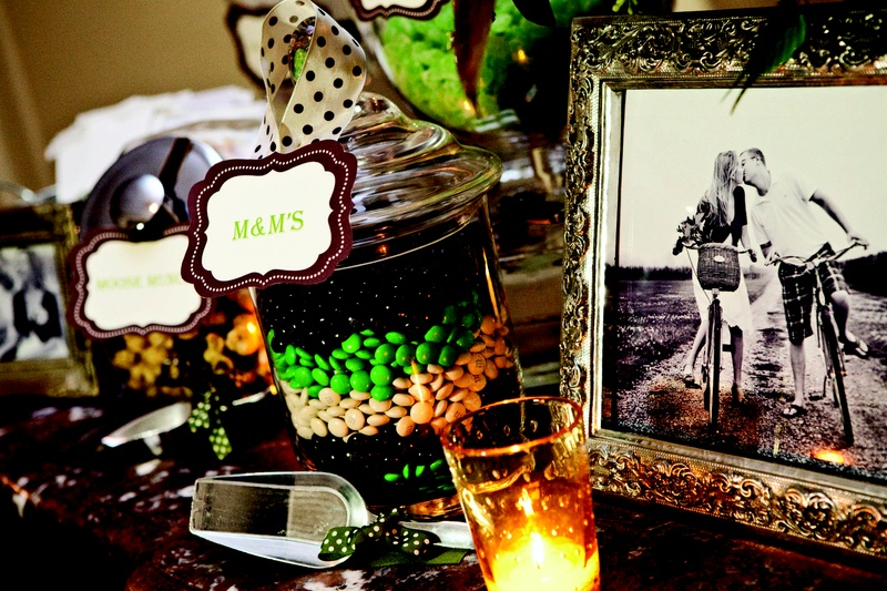 M&M's and candies in apothecary jars at wedding reception