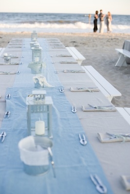 Long picnic table on beach sand