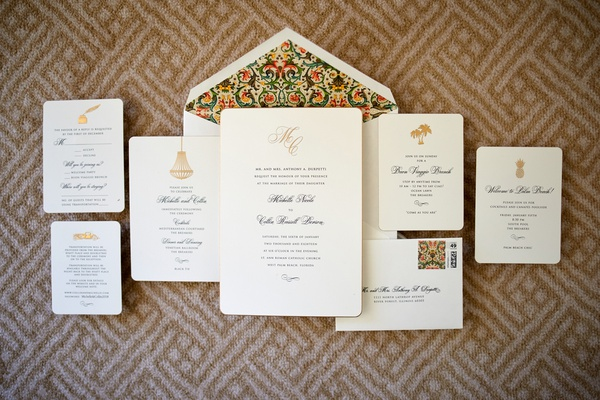 invitation suite with tropical emblem and patterned envelope liner