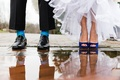 Groom with blue & green argyle socks, black shoes, bride with dark blue Badgley Mischka pumps