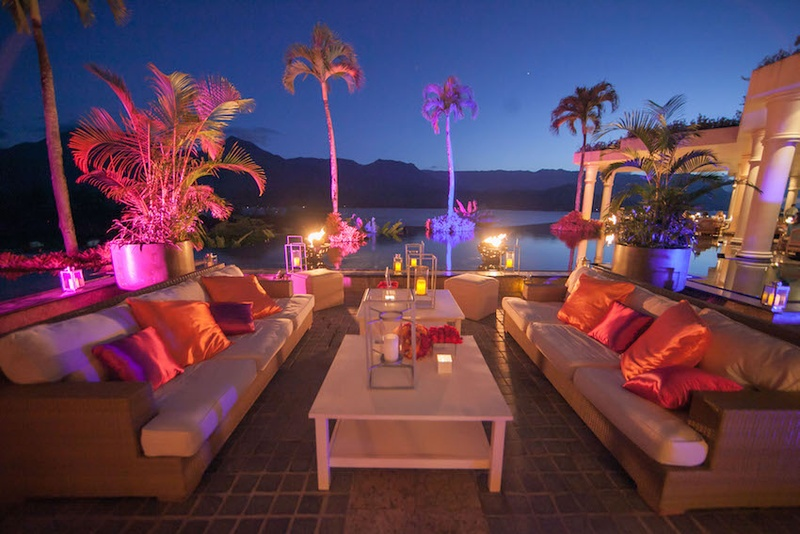 Outdoor lounge area with vibrant lights and pillows