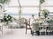 Open side clear tent wedding reception blue grey green cream mismatch chairs