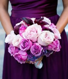 Purple and pink roses and calla lily flowers