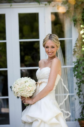 Bride showing off romantic bridal look
