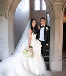 Bride in monique lhuillier wedding dress peplum tulle long train veil white bouquet groom in tuxedo