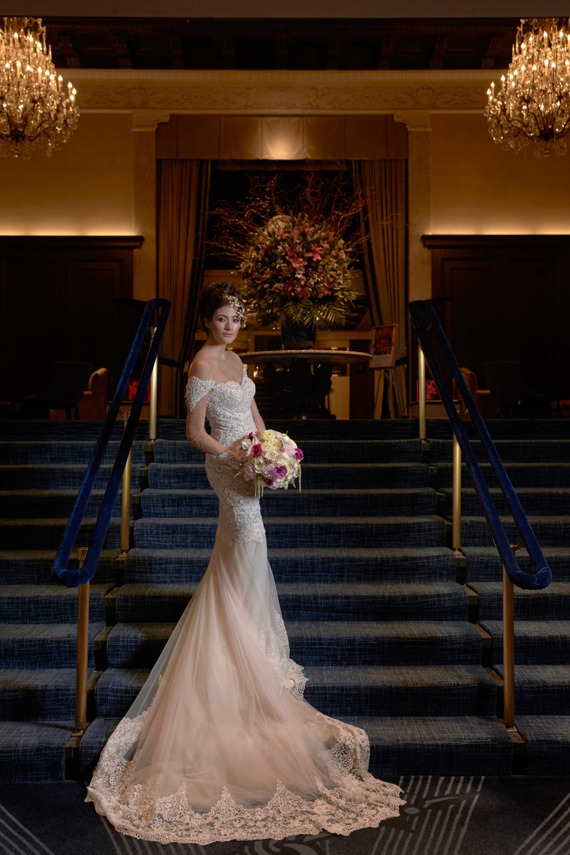 lace bridal gown sweetheart neckline sleeves long train blush pink and white bouquet
