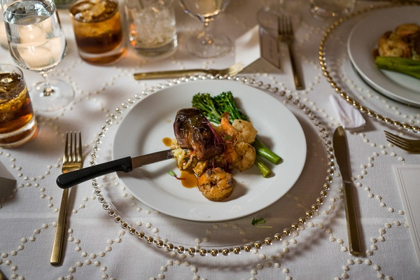 wedding reception meal, filet with garlic butter shrimp, potato hash, broccolini