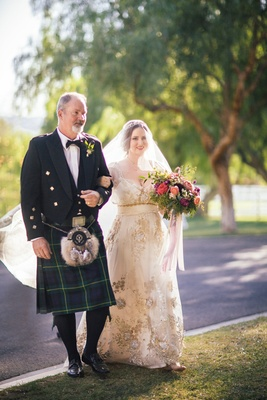 Bride in a Claire Pettibone dress with gold and silver embroidery, veil, and father in a blue kilt