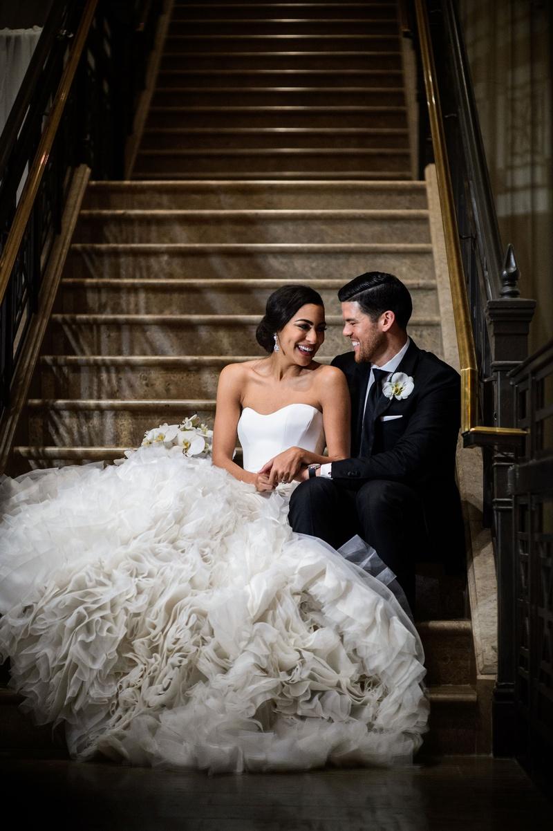wedding portrait bride in pretty ines di santo wedding dress with ruffle texture skirt groom suit