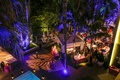 Night photo of outdoor pool cabana reception