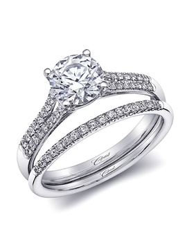 Engagement ring with split shank and matching diamond band
