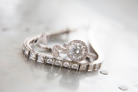 Diamond bracelet with initial ring and round halo engagement ring