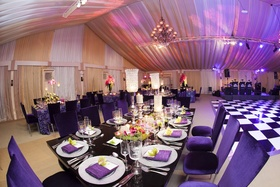 Black tables surrounded by purple reception chairs