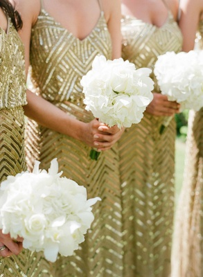 White hydrangea rose flower bouquet for bridesmaids in gold sequin sheath gowns